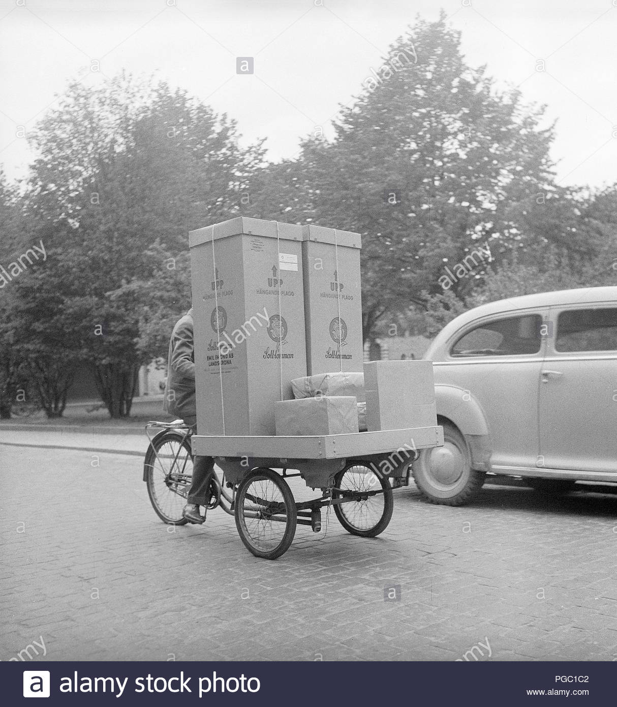 1950s-transportation-a-man-is-working-as-a-bicycle-messanger-and-transporting-goods-in-stockho...jpg