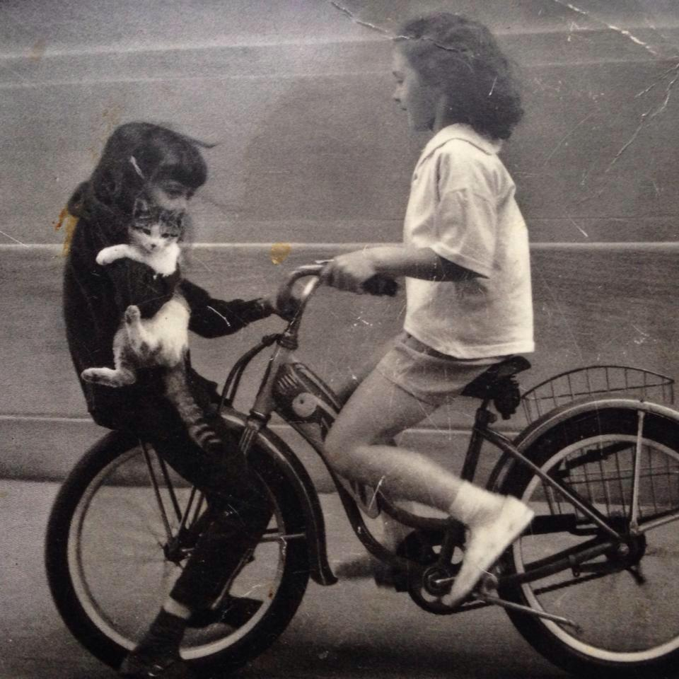 2 girls cat bike.jpg
