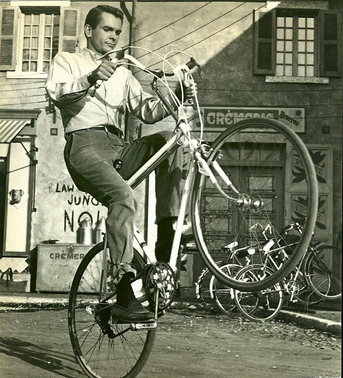 Dean Jones wheelies a bike, 1967.jpg