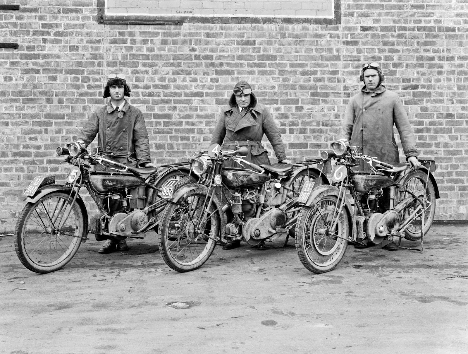 Motorcyclists and Raleigh motorcycles, ca. 1920s.jpg