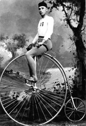 racer-on-big-wheel-bike-e1392882146878.jpg