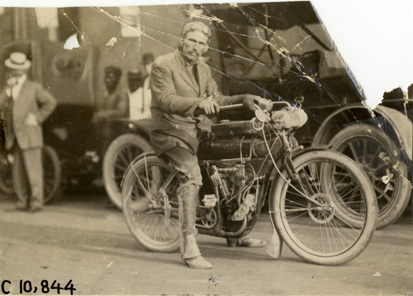 View_of_motorcyclist_posing_with_Indian_motorcycle_during_1909_motorcycle_races_in_Indianapolis.jpg