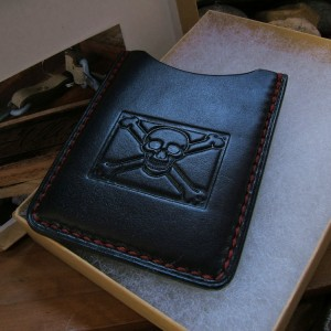 "Available: ""No Quarter"" in black saddle with blood red stitch"