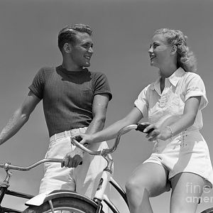 Smiling-couple-on-bikes-Colsons