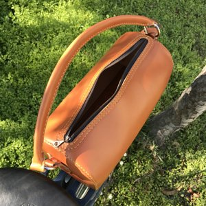 saddle stitched english bridle bag for rack