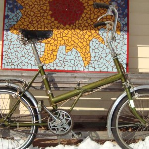 The Raleigh Twenty rides surprisingly well and was once owned by a little old lady in Florida.  It was gifted to me.